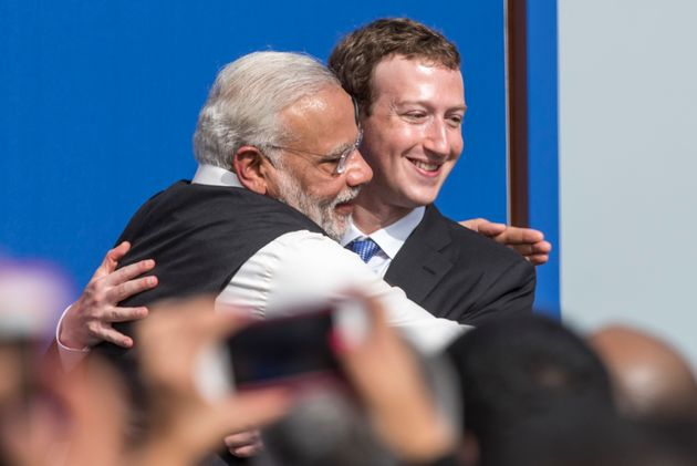 File photo of Prime Minister Narendra Modi, left, and Mark Zuckerberg, CEO of Facebook Inc., embracing...