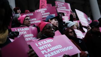 "NEW YORK, NEW YORK - FEBRUARY 25: Pro-choice activists, politicians and others associated with Planned Parenthood gather for a news conference and demonstration at City Hall against the Trump administrations title X rule change on February 25, 2019 in New York City. The proposed final rule for the Title X Family Planning Program, called the ""Gag Rule,"" would force a medical provider receiving federal assistance to refuse to promote, refer for, perform or support abortion as a method of family planning. (Photo by Spencer Platt/Getty Images)"