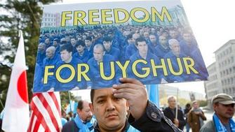 Uyghurs people demonstrate against China during the Universal Periodic Review of China by the Human Rights Council, walking to the place des Nations in front of the European headquarters of the United Nations, in Geneva, Switzerland, Tuesday, Nov. 6, 2018.