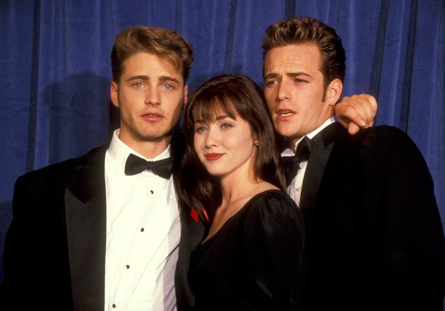 Luke Perry (right) with his Beverly Hills 90210 co-stars Shannen Doherty and Jason