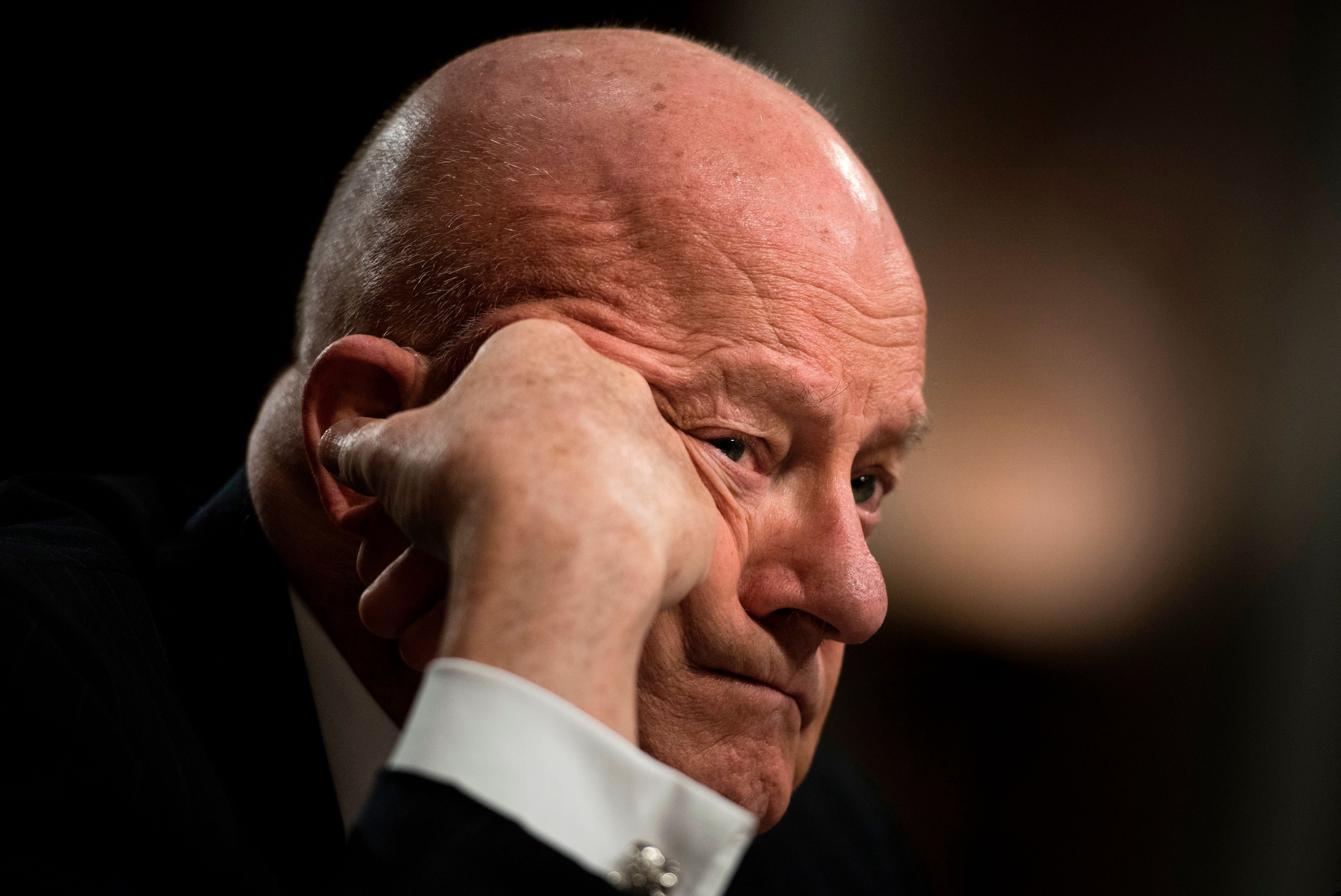 Former Director of National Intelligence James Clapper listens during a hearing of the Senate Armed Services Committee on Capitol Hill May 11, 2017 in Washington, DC. / AFP PHOTO / Brendan Smialowski        (Photo credit should read BRENDAN SMIALOWSKI/AFP/Getty Images)