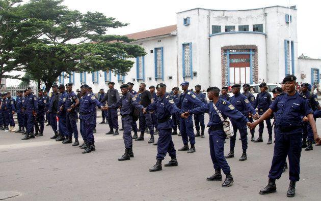 Riot policemen parade before blocking demonstrators during a protest against President Joseph Kabila...