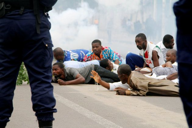 Riot policemen fire teargas canisters to disperse demonstrators during a protest organised by Catholic...
