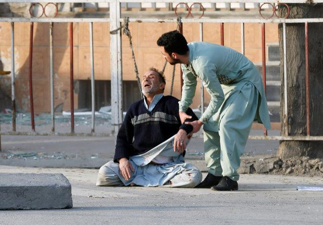 A man reacts after hearing his son was killed during a car bomb attack in Kabul, Afghanistan January...