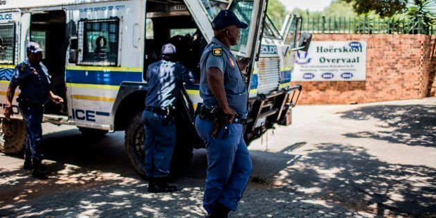 South African Police officers outside Hoërskool Overvaal during a