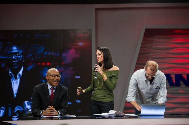 The New Age and ANN7 proprietor Mzwanele Manyi is seen with two investigative journalists, Pauli Van...