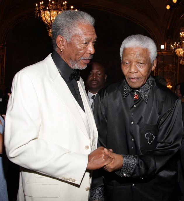 Actor Morgan Freeman (L) and Nelson Mandela attend the 'Unite For A Better World Gala Dinner' on September...