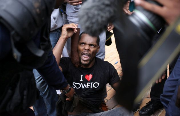 Student leader Mcebo Dlamini is detained during clashes with South African police at Johannesburg's University...