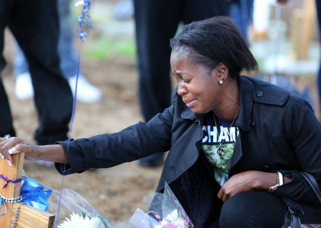Peguy Kato mourning her son at his graveside on what would've been his 18th