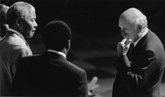 December 20, 1991: Nelson Mandela talks to FW de Klerk with Cyril Ramaphosa during CODESA