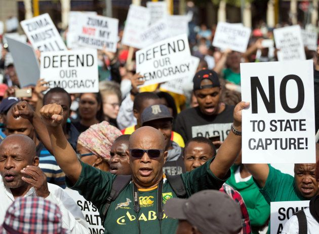 Demonstrators take part in a protest calling for the removal of South Africa's President Jacob Zuma,...
