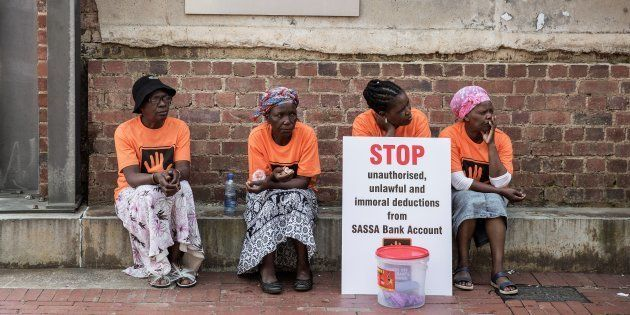 A member of the South African human rights nongovernmental organisation Black Sash holds a placard outside...