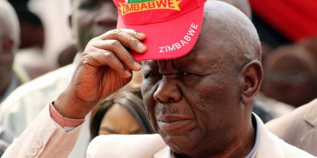 Zimbabwe's opposition Movement for Democratic Change (MDC) leader Morgan Tsvangirai reacts after arriving...