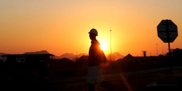 A miner returns from his shift in Nkaneng township outside the Lonmin mine in
