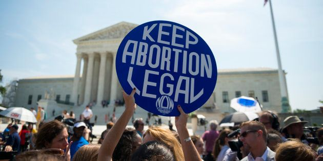 Pro-choice supporters celebrate in front of the U.S. Supreme Court after the court, in a 5-3 ruling,...