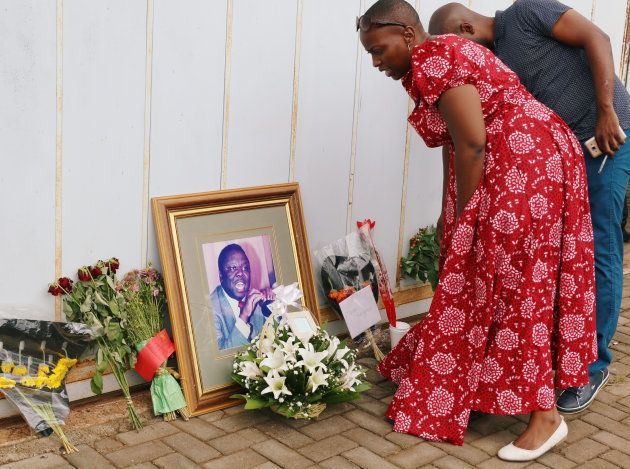 Mourners place flowers as they pay respects to Movement For Democratic Change (MDC) leader Morgan Tsvangirai...