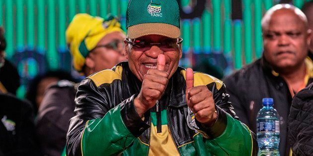 South African President Jacob Zuma gives the thumbs to the audience as he arrives to the opening session...