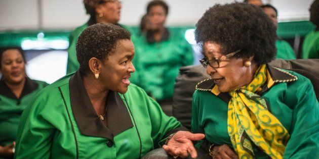 Africa National Congress stalwart Winnie Madikizela Mandela (R) listens to ANC Women League president...