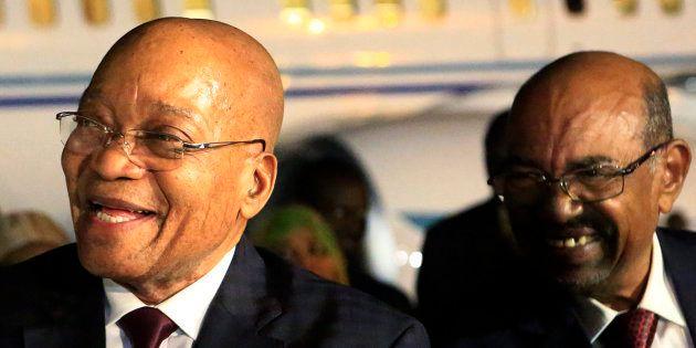 Sudanese President Omar al-Bashir (r) welcomes South African President Jacob Zuma at Khartoum airport...