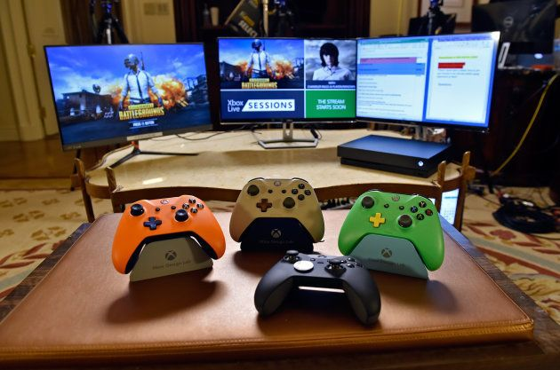 Microsoft Xbox One Elite Controller (2nd R) and Xbox Design Lab controllers are displayed during an Xbox...