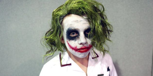 A man dressed as the Joker from the Batman franchise poses for a portrait at the London Film and Comic...