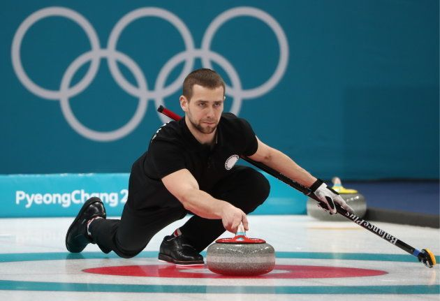 Curler Alexander Krushelnitsky, Olympic Athlete from Russia, delivers a stone in the mixed doubles curling...