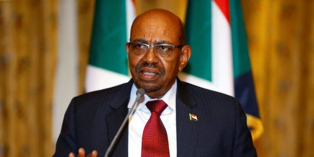 Sudan's President Omar Al Bashir addresses a news conference at the national palace during his official...