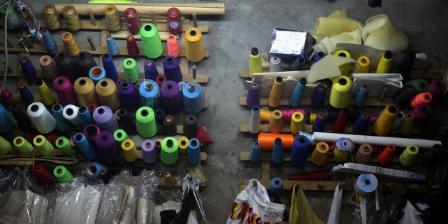Sewing threads are seen at a family-owned factory at a house in Lima, Peru, July 12,
