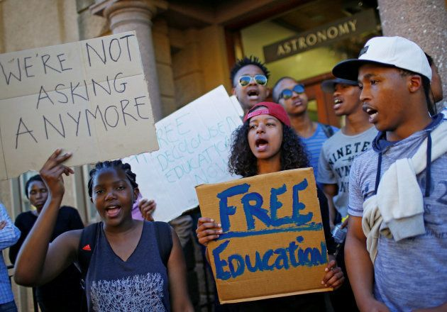 University of Cape Town (UCT) students hold placards during protests demanding free tertiary education...