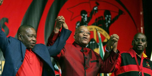 South African President Jacob Zuma (C) holds hands with Blade Nzimande (L) and President of Cosatu Sdumo...