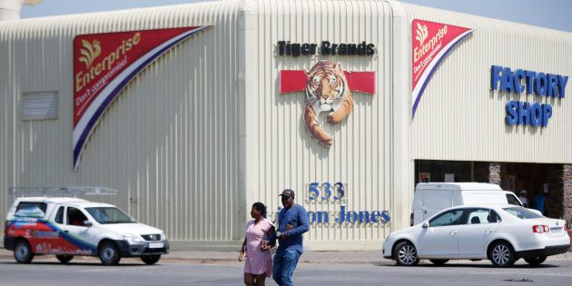 A couple leaves Tiger Brands factory shop in Germiston, Johannesburg, South Africa, March 5, 2018. REUTERS/Siphiwe