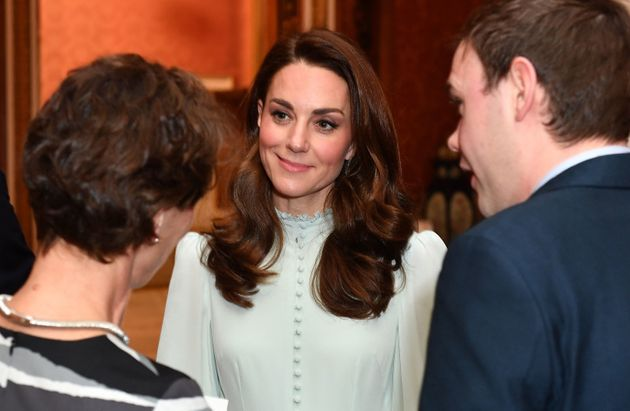 Catherine, Duchess of Cambridge, talks with guests as she attends a reception to mark the 50th Anniversary...