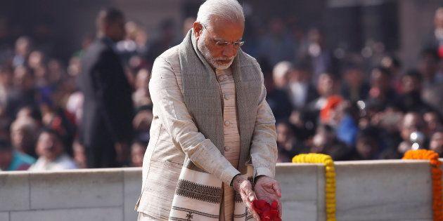 India's Prime Minister Narendra Modi pays his respects at the Mahatma Gandhi memorial on Gandhi?s death...