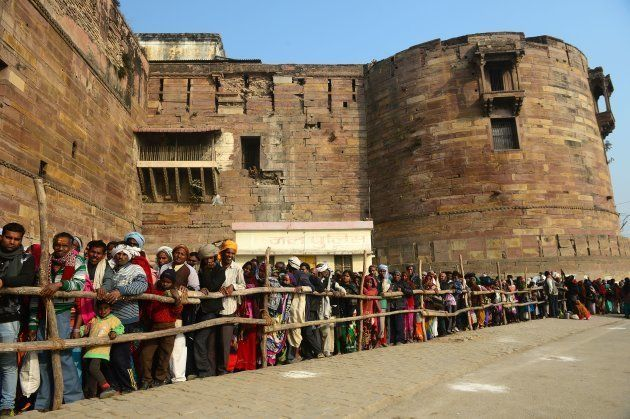Indian Hindu devotees wait in queue outside OD Ford to worship an ancient Holy tree 'Akshayavat' on the...