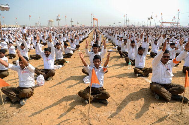 Indian volunteers of the right-wing Hindu nationalist group Rashtriya Swayamsevak Sangh (RSS) gather...