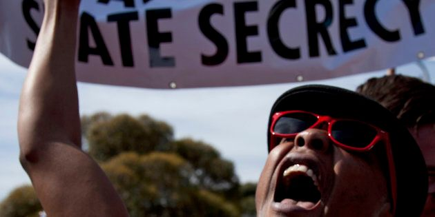 Protesters take part in a demonstration against the Protection of Information Bill in Cape Town September...