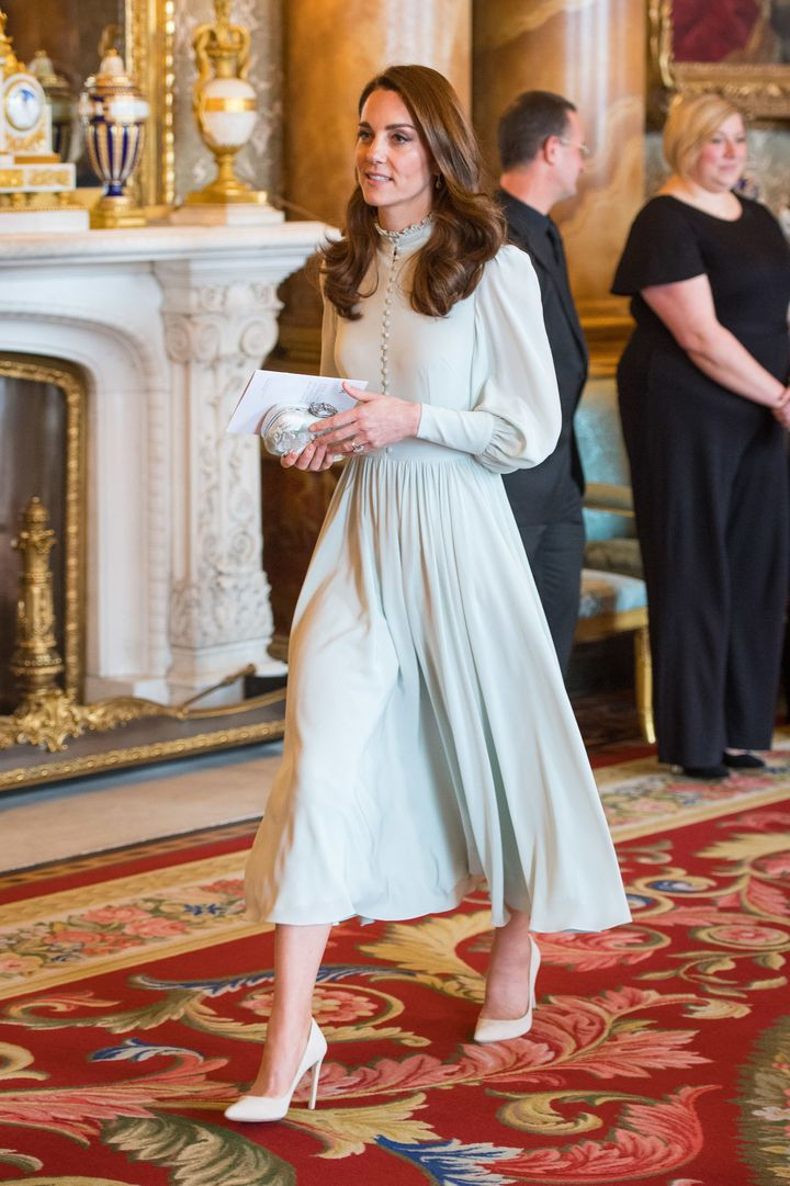 The duchess accessorized her look with a bejeweled clutch and white pumps.
