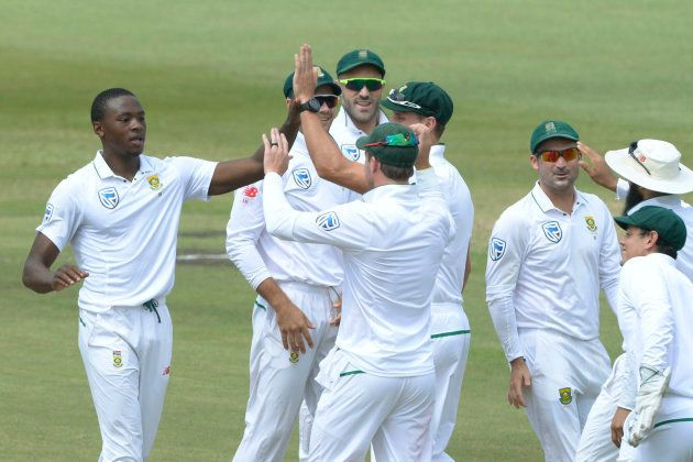 Kagiso Rabada of the Proteas celebrates the wicket of Tim Paine of Australia with his team mates during...