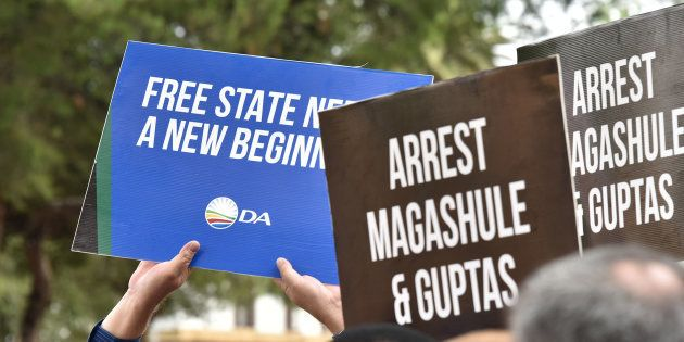 DA and EFF members demonstrate in front of the Bloemfontein Regional Court as the suspects linked to...