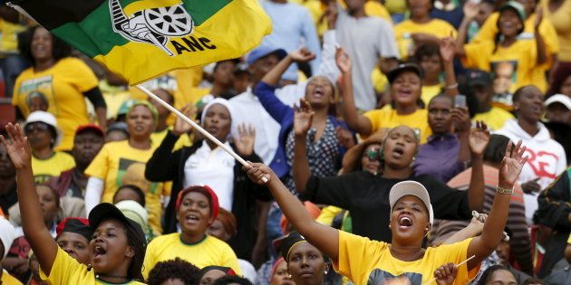Supporters of South African President Jacob Zuma's ruling African National Congress (ANC) cheer at a...