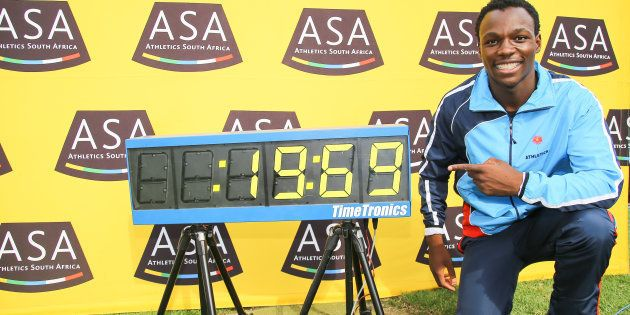 Clarence Munyai at the clock, after he ran a new South African record of 19.69 seconds in the men's 200m...