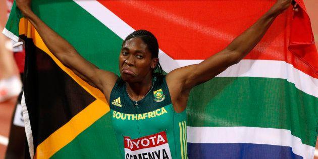 Caster Semenya of South Africa celebrates winning the final. REUTERS/John
