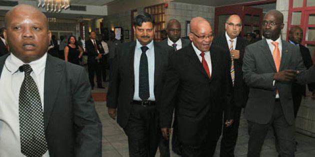 President Zuma accompanied by Atul Gupta, Minister of Public Enterprise Malusi Gigaba and CEO of The...
