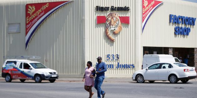 A couple leaves Tiger Brands factory shop in Germiston, Johannesburg, South Africa, March 5,