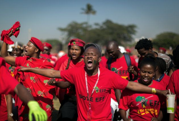 Supporters of South African radical-left opposition party Economic Freedom Fighters (EFF) gesture as...