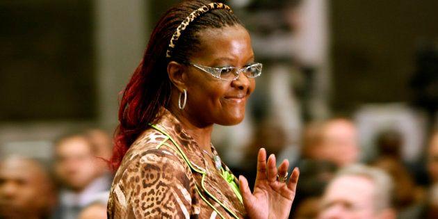 Grace Mugabe, wife of Zimbabwean President Robert Mugabe, waves on arrival for the opening of the summit...