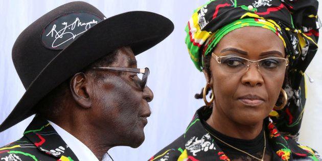 President Robert Mugabe and his wife Grace attend a rally of his ruling ZANU (PF) in Chinhoyi, Zimbabwe,...
