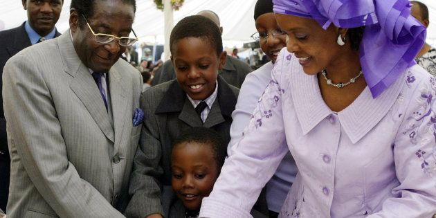 Happier days: Zimbabwe's President Robert Mugabe (L), his wife Grace (R) and children Chatunga (C front),...