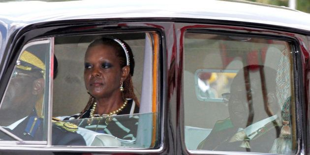 Zimbabwe President Robert Mugabe and his wife Grace arrive at the Parliament in Harare, October 28,