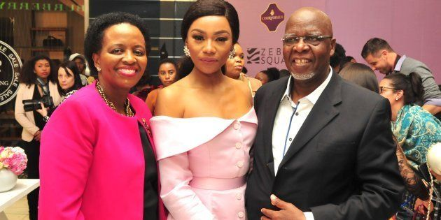 Bonang Matheba poses with her parents Andrew Gampi Matheba and Charlotte during her book launch at Sandton...